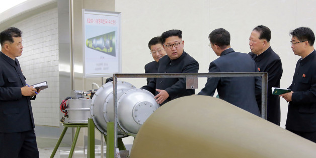 This undated picture released by North Korea's official Korean Central News Agency (KCNA) on September 3, 2017 shows North Korean leader Kim Jong-Un (C) looking at a metal casing with two bulges at an undisclosed location. North Korea has developed a hydrogen bomb which can be loaded into the country's new intercontinental ballistic missile, the official Korean Central News Agency claimed on September 3. Questions remain over whether nuclear-armed Pyongyang has successfully miniaturised its weapons, and whether it has a working H-bomb, but KCNA said that leader Kim Jong-Un had inspected such a device at the Nuclear Weapons Institute. / AFP PHOTO / KCNA VIA KNS / STR / South Korea OUT / REPUBLIC OF KOREA OUT   ---EDITORS NOTE--- RESTRICTED TO EDITORIAL USE - MANDATORY CREDIT 'AFP PHOTO/KCNA VIA KNS' - NO MARKETING NO ADVERTISING CAMPAIGNS - DISTRIBUTED AS A SERVICE TO CLIENTS THIS PICTURE WAS MADE AVAILABLE BY A THIRD PARTY. AFP CAN NOT INDEPENDENTLY VERIFY THE AUTHENTICITY, LOCATION, DATE AND CONTENT OF THIS IMAGE. THIS PHOTO IS DISTRIBUTED EXACTLY AS RECEIVED BY AFP.  /         (Photo credit should read STR/AFP/Getty Images)