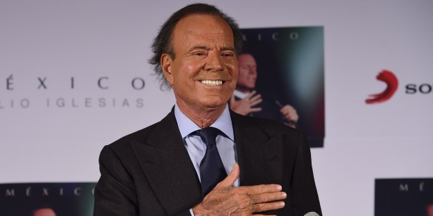 Spanish singer Julio Iglesias gestures before a press conference in Mexico city, on September 23, 2015. Iglesias is in Mexico to promote his new album 'Mexico'. AFP PHOTO/RONALDO SCHEMIDT        (Photo credit should read RONALDO SCHEMIDT/AFP/Getty Images)