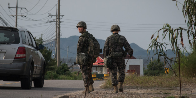 South Korean soldiers walk to a checkpoint at the Demilitarized zone (DMZ) separating North and South Korea, on Ganghwa island on September 4, 2017. North Korea could be preparing another missile launch, Seoul said September 4 as it strengthened its defences following Pyongyang's biggest-ever nuclear test and declaration it had a hydrogen bomb. / AFP PHOTO / Ed JONES        (Photo credit should read ED JONES/AFP/Getty Images)