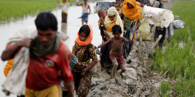 Rohingya refugees walk on the muddy path after crossing the Bangladesh-Myanmar border in Teknaf, Bangladesh, September 3, 2017. REUTERS/Mohammad Ponir Hossain