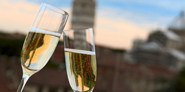 Two glasses of champagne with the Tower of Pisa in the background