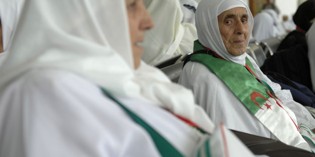 An Algerian pilgrim waits at Algiers airport on August 29, 2016, ahead of her departure to the annual Hajj pilgrimage in the Islamic holy cities of Mecca and Medina in Saudi Arabia.The Hajj, the largest annual pilgrimage in the world, is the fifth pillar of Islam, a religious duty that must be carried out at least once in the lifetime of every able-bodied Muslim who can afford to do so. / AFP / RYAD KRAMDI        (Photo credit should read RYAD KRAMDI/AFP/Getty Images)