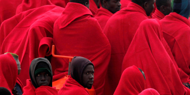 Migrants, who were part of a group intercepted aboard a dinghy off the coast in the Mediterranean sea, wrapped in blankets on a rescue boat upon arriving at a port in Malaga, southern Spain, December 3, 2016. REUTERS/Jon Nazca