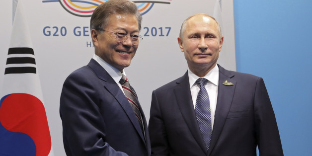 Russia's President Vladimir Putin (R) shakes hands with South Korea's President Moon Jae-in during a meeting on the sidelines of the G20 summit in Hamburg, Germany July 7, 2017 Sputnik/Mikhail Klimentyev/Kremlin via REUTERS ATTENTION EDITORS - THIS IMAGE WAS PROVIDED BY A THIRD PARTY. EDITORIAL USE ONLY.