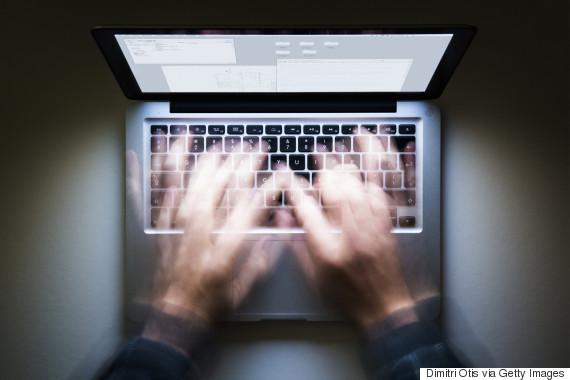 laptop night guy hands