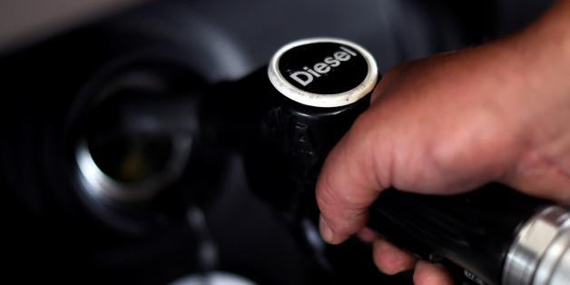 A man fuels his car at a petrol station in London, Britain, July 26, 2017. REUTERS/Hannah McKay