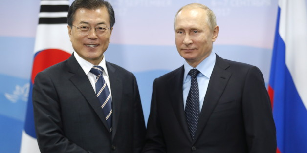 VLADIVOSTOK, RUSSIA - SEPTEMBER 6, 2017: South Korea's President Moon Jae-in (L) and Russia's President Vladimir Putin shake hands during a meeting as part of the 2017 Eastern Economic Forum at Far Eastern Federal University on Russky Island. Mikhail Metzel/TASS Host Photo Agency (Photo by Mikhail Metzel\TASS via Getty Images)