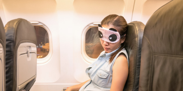 Asian woman traveller sleeping in the airplane