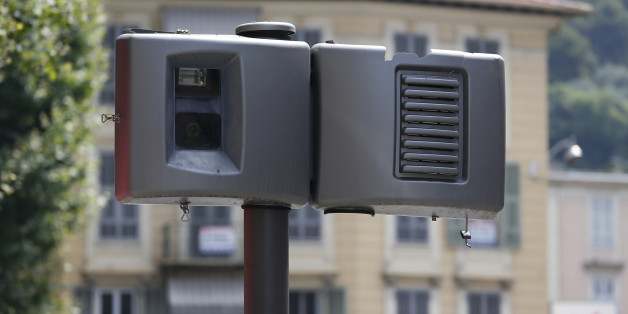 A new automatic traffic light radar is seen defaced on July 13, 2013 in Nice. The automatic radars check the speed of vehicles.  AFP PHOTO / VALERY HACHE        (Photo credit should read VALERY HACHE/AFP/Getty Images)
