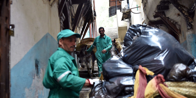 Garbage collectors lead donkeys in the old part of Algiers, known as the 'Kasbah', on May 22, 2017 as they collect the rubbish in the alleyways of this medina built during the 10th century under Zirid rule. It's a rubbish job, but someone has to do it. Or some animal: in the alleyways of Algiers' famed Kasbah, donkeys shift tonnes of trash every day. / AFP PHOTO / RYAD KRAMDI        (Photo credit should read RYAD KRAMDI/AFP/Getty Images)