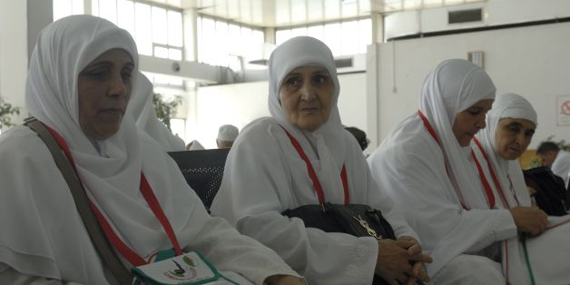 Algerian pilgrims gather at Algiers airport on August 29, 2016, for their departure to the annual Hajj pilgrimage in the Islamic holy cities of Mecca and Medina in Saudi Arabia.The Hajj, the largest annual pilgrimage in the world, is the fifth pillar of Islam, a religious duty that must be carried out at least once in the lifetime of every able-bodied Muslim who can afford to do so. / AFP / RYAD KRAMDI        (Photo credit should read RYAD KRAMDI/AFP/Getty Images)