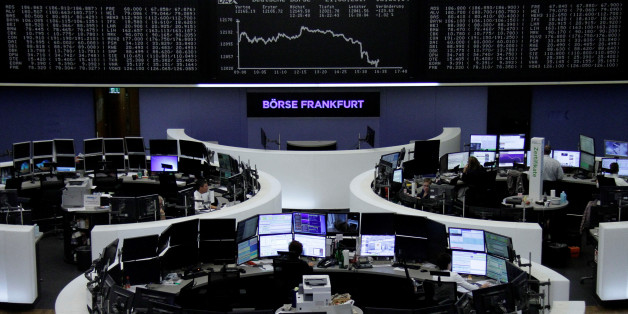 Traders work in front of the German share price index, DAX board, at the stock exchange in Frankfurt, Germany, August 21, 2017. REUTERS/Staff/Remote