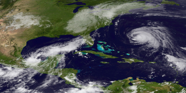 IN SPACE - SEPTEMBER 7:  In this satellite handout from NOAA, the remnants of Tropical Storm Lee are seen over the eastern U.S. after having been absorbed by a frontal system as Hurricane Katia churns in the Atlantic September 7, 2011 as seen from space. As the remnants of Lee are dumping rains along the Eastern U.S., prompting flood watches, Katia churns in the Atlantic ocean as a Category 2 storm, although it is not expected to make landfall.  (Photo by NOAA via Getty Images)