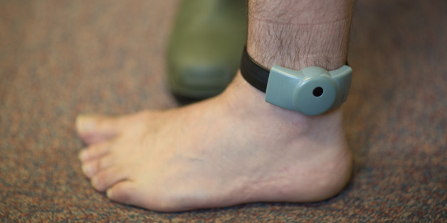 An electronic tag around an ankle