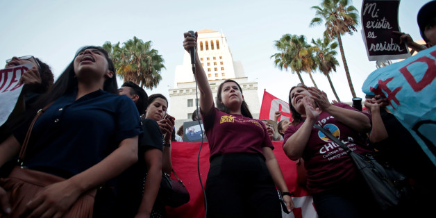 Melanie, a Deferred Action for Childhood Arrivals (DACA) program recipient, leads a chant with supporters at City Hall in Los Angeles, California, September 5, 2017. REUTERS/ Kyle Grillot