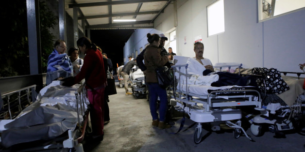 Patients and family members are seen outside the Institute for Social Security and Services for State Workers (ISSSTE) after an earthquake struck off the southern coast of Mexico late on Thursday, in Puebla, Mexico September 8, 2017. REUTERS/Imelda Medina
