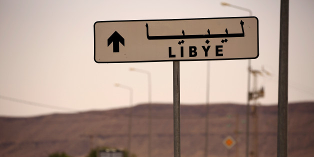 A road sign shows the direction of Libya near the border crossing at Dhiba, Tunisia April 11, 2016.  Tunisia's 2011 uprising created fertile ground for jihadist recruiters. Hundreds of Islamist militants were freed from prison as part of an amnesty for those detained under Ben Ali. Ultra-conservative salafists began to flex their muscle, seizing control of mosques and clashing with secularists. As Tunisia's politics have stabilised, the government has reasserted control, taking back mosques, ban