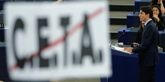 Canada's Prime Minister Justin Trudeau is seen behind a poster with a crossed CETA (Comprehensive Economic Trade Agreement) sign as he adresses the European Parliament in Strasbourg, France, February 16, 2017. REUTERS/Vincent Kessler