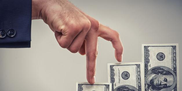 Close up concept shot of fingers walking crawling up a pile of one hundred dollar billshttp://195.154.178.81/DATA/i_collage/pi/shoots/783303.jpg