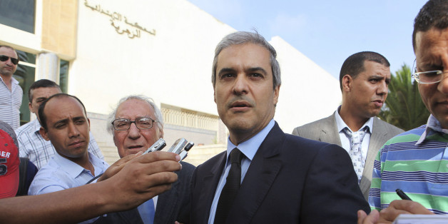 Prince Moulay Hicham, cousin of Morocco's King Mohammed VI, speaks to the press accompanied by his lawyer Abderrahim Berrada (centre L) after leaving the Ain Sebaa Court in Casablanca September 17, 2012. The Moroccan Prince has filed a lawsuit against Member of Parliament Abdelhadi Khairat on grounds of defamation. REUTERS/Macao (MOROCCO - Tags: ROYALS POLITICS CRIME LAW)