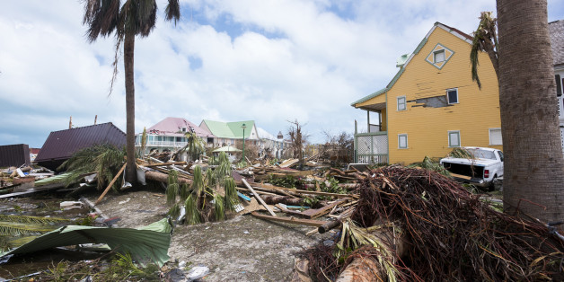 TOPSHOT - A photo taken  on September 7, 2017 shows damage in Orient Bay on the French Carribean island of Saint-Martin, after the passage of Hurricane Irma.France, the Netherlands and Britain on September 7 rushed to provide water, emergency rations and rescue teams to territories in the Caribbean hit by Hurricane Irma, with aid efforts complicated by damage to local airports and harbours. The worst-affected island so far is Saint Martin, which is divided between the Netherlands and France, whe