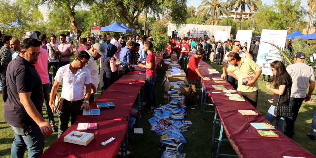 Iraqis attend the 'I'm Iraqi, I Read' cultural festival at Abu Nawas street, along the Tigris river in the capital Baghdad, on September 9, 2017.It's far from the image most have of the Iraqi capital-- but for one day this weekend on the banks of the Tigris, Iraqi readers were able to find some respite from the country's violence in the simple joy of losing themselves in a book. / AFP PHOTO / SABAH ARAR        (Photo credit should read SABAH ARAR/AFP/Getty Images)