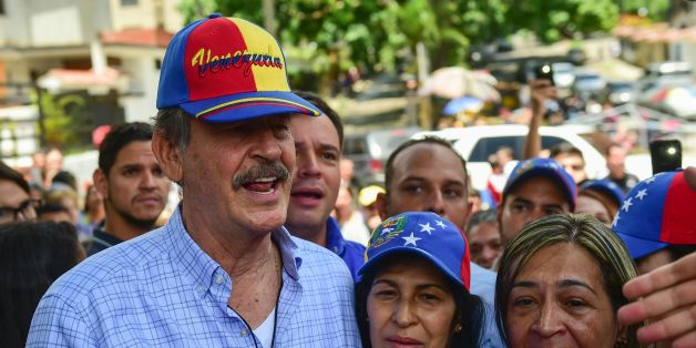 Former Mexican president Vicente Fox (L), named by the Venezuelan opposition as an observer to the opposition-organized vote to measure public support for Venezuelan President Nicolas Maduro's plan to rewrite the constitution, is pictured at a polling station in Caracas on July 16, 2017.Authorities have refused to greenlight the vote that has been presented as an act of civil disobedience and supporters of Maduro are boycotting it. Protests against Maduro since April 1 have brought thousands to