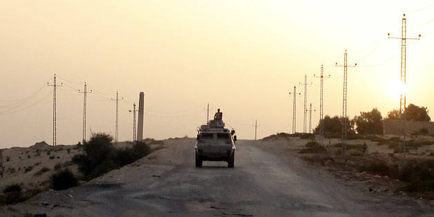 FILE PHOTO: An Egyptian military vehicle is seen on the highway in northern Sinai, Egypt, May 25, 2015.   To match Special Report EGYPT-POLITICS/SINAI      REUTERS/Asmaa Waguih/File Photo