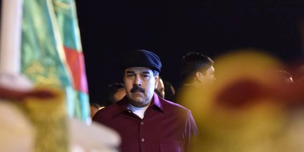 Venezuelan President Nicolas Maduro arrives at the Houari Boumedien Airport in Algiers for a two-day visit on September 10, 2017.Maduro is visiting fellow oil exporter Algeria days after announcing his country would sell crude in non-dollar currencies in a bid to resist US sanctions. / AFP PHOTO / RYAD KRAMDI / RYAD KRAMDI        (Photo credit should read RYAD KRAMDI/AFP/Getty Images)