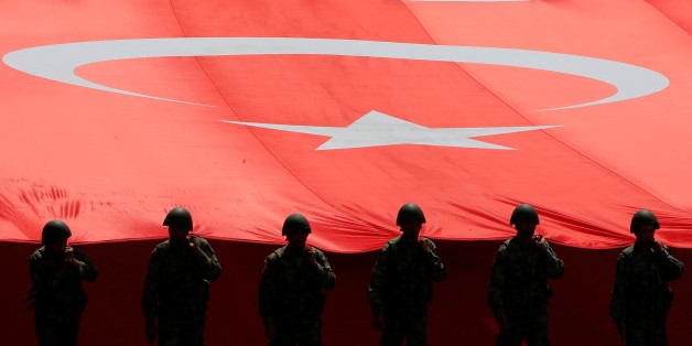 ANKARA, TURKEY - AUGUST 30 : Turkish soldiers hold a Turkish flag as they parade from the Grand National Assembly of Turkey (TBMM) to the first Turkish Grand National Assembly building in the Ulus district during the celebrations to mark 95th Anniversary of Turkeys Victory Day which commemorates decisive battle in country's 1919-1922 Independence War in Ankara, Turkey on August 30, 2017. (Photo by Murat Kaynak/Anadolu Agency/Getty Images)