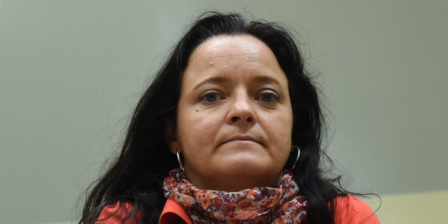 Defendant Beate Zschaepe waits for the continuation of her trial at a courtroom in Munich, southern Germany, on August 1, 2017.Zschaepe is accused of helping found a neo-Nazi cell, the National Socialist Underground (NSU), and of complicity in the murders of eight Turks, a Greek and a German police woman across Germany between 2000 and 2007, as well as two bombings in immigrant areas of Cologne and 15 bank robberies. / AFP PHOTO / POOL / Christof STACHE        (Photo credit should read CHRISTOF