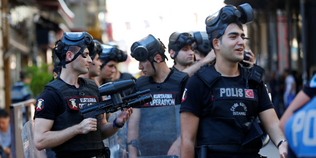 Riot police stand guard as LGBT rights activists try to gather for a pride parade, which was banned by the governorship, in central Istanbul, Turkey, June 25, 2017. REUTERS/Murad Sezer