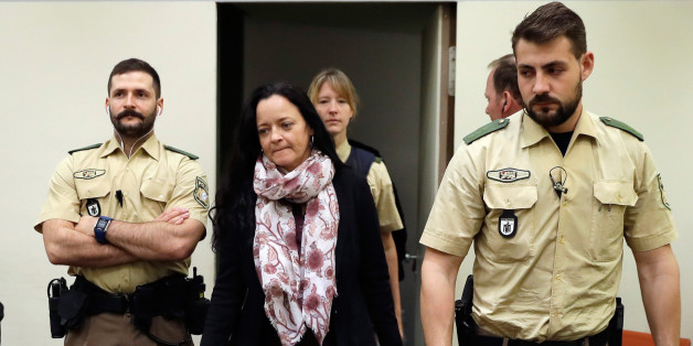 Defendant Beate Zschaepe (2nd L) arrives at a courtroom on September 12, 2017 in Munich, southern Germany.