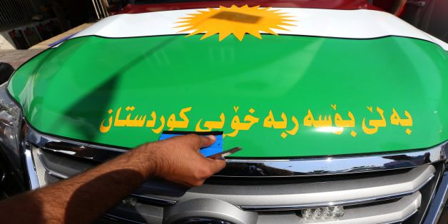 An Iraqi Kurdish man decorates a car with the Kurdish flags ahead of the upcoming independence referendum in Arbil, the capital of the autonomous Kurdish region of northern Iraq, on September 7, 2017. Iraq's autonomous Kurdish region will hold a historic referendum on statehood in September 2017, despite opposition to independence from Baghdad and possibly beyond.  / AFP PHOTO / SAFIN HAMED        (Photo credit should read SAFIN HAMED/AFP/Getty Images)