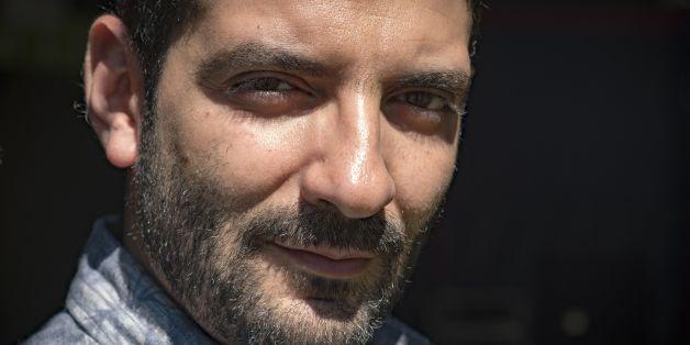 Le realisateur algerien Karim Moussaoui.  AFP PHOTO / Eric CABANIS        (Photo credit should read ERIC CABANIS/AFP/Getty Images)