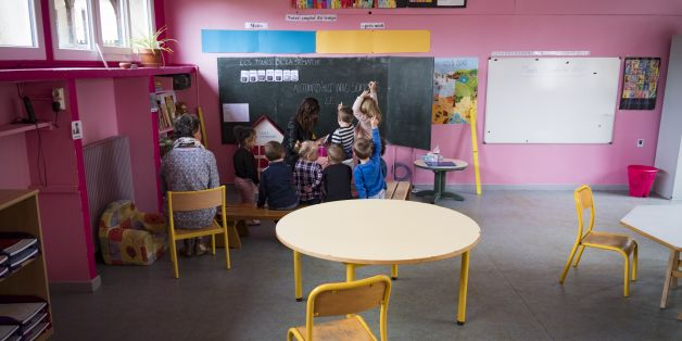 Children attend a lesson with their teacher in the preschool in Molieres, southwest France, on September 5, 2017. 'The school is the life of the commune,' according to the mayor of Molières. The school in this rural commune in the Lot department was supposed to close, but parents of pupils and the town hall decided to recruit a teacher and open a class outside contract, to 'save the life of the village'. / AFP PHOTO / ERIC CABANIS        (Photo credit should read ERIC CABANIS/AFP/Getty Images)