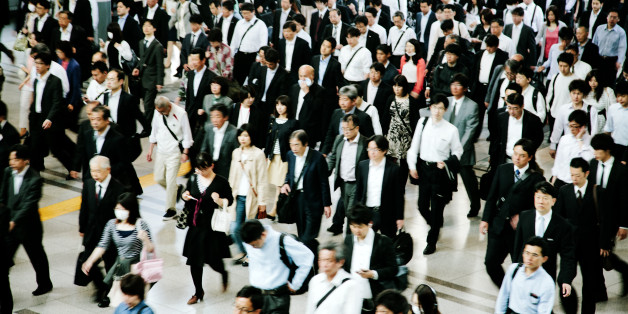 A busy pedestrian walkway, businessmen and women, walking to work, motion blurred, Tokyo. Horizontal composition.