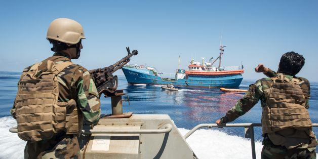 Libyan coastguards stand on an armoured boat as they patrol the area at sea between Sabratha and Zawiyah on July 28, 2017.  / AFP PHOTO / TAHA JAWASHI        (Photo credit should read TAHA JAWASHI/AFP/Getty Images)
