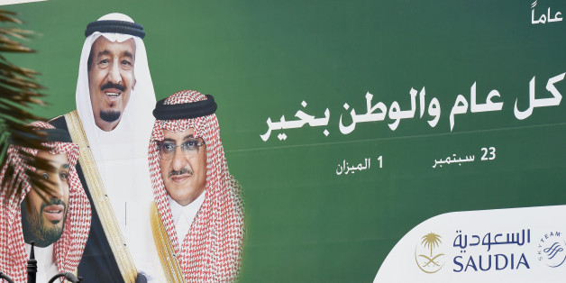 A picture taken on June 6, 2017 shows a poster of Saudi King Salman (C), Crown Prince and Interior Minister Mohammed bin Nayef (R) and Deputy Crown Prince and Defence Minister Mohammed bin Salman placed on on the offices of the Saudi national airline carrier in Riyadh.Arab nations including Saudi Arabia and Egypt cut ties with Qatar accusing it of supporting extremism, in the biggest diplomatic crisis to hit the region in years. / AFP PHOTO / FAYEZ NURELDINE        (Photo credit should read FAYE