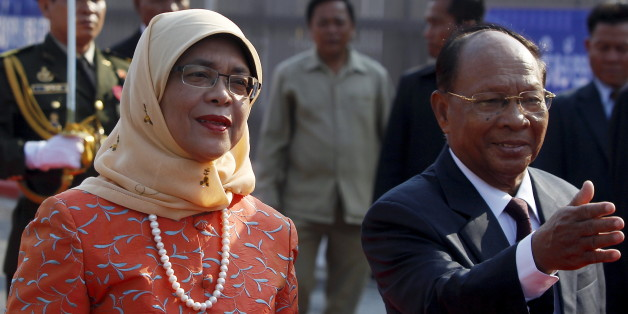 Halimah Yacob (L),  Speaker of the Parliament of Singapore inspects the honour guard, accompanied by Cambodia's President of the National Assembly Heng Samrin (R) during an official welcoming ceremony in front of the Cambodian National Assembly in Phnom Penh May 7, 2015. Yacob is on a three-day visit to Cambodia. REUTERS/Samrang Pring