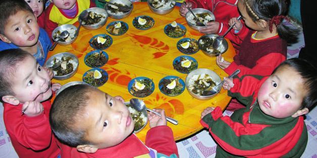 PYONGAN, NORTH KOREA - FEBRUARY 21:  North Korean children eat lunch, including rice, provided by the United Nations World Food Programme, at a nursery on February 21, 2005 in Yomju county, North Pyongan province in North Korea. The WFP and UNICEF have stated that while child malnutrition rates in North Korea fell during the last two years, continued international assistance is needed to build on the gains. (Photo by Gerald Bourke/WFP via Getty Images)