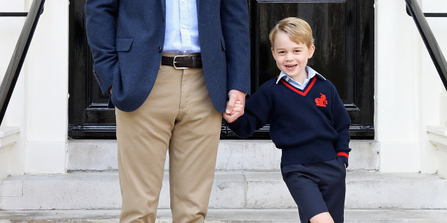 """LONDON, ENGLAND - SEPTEMBER 07: (In this handout photo released by the Duke and Duchess of Cambridge) Prince William, the Duke of Cambridge with his son Prince George on his first day of school on September 7, 2017 in London, England. The picture was taken at Kensington Palace in London shortly before Prince George left for his first day of school at Thomas's Battersea. Photographer Chris Jackson who took the picture said """"The first day of school is an exciting time for any child, and it wa"""