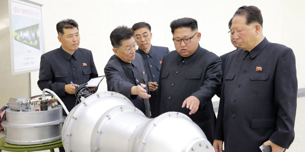 TOPSHOT - This undated picture released by North Korea's official Korean Central News Agency (KCNA) on September 3, 2017 shows North Korean leader Kim Jong-Un (C) looking at a metal casing with two bulges at an undisclosed location.North Korea has developed a hydrogen bomb which can be loaded into the country's new intercontinental ballistic missile, the official Korean Central News Agency claimed on September 3. Questions remain over whether nuclear-armed Pyongyang has successfully miniaturised