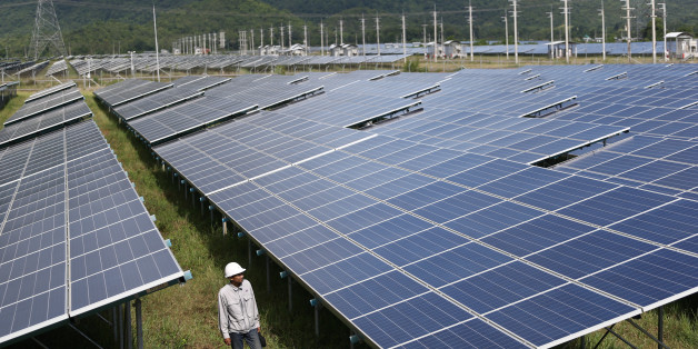 A worker walks at a solar power plant by Superblock, Southeast Asia's biggest producer of solar power in Phetchaburi province, Thailand, August 23, 2017. REUTERS/Athit Perawongmetha