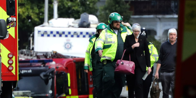 An injured woman is led away after an incident at Parsons Green underground station in London, Britain, September 15, 2017.  REUTERS/Luke MacGregor