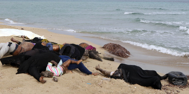 EDITORS NOTE: Graphic content / The bodies of illegal migrants are seen lying on the beach in Garabulli, east of the capital Tripoli, on October 6, 2016 after their boat capsized off the shore of Libya. With its 1,770 kilometres (1,100 miles) of coastline, Libya has become a hub for illegal migration towards Europe, lacking proper border controls in a country plunged into chaos.   / AFP / MAHMUD TURKIA        (Photo credit should read MAHMUD TURKIA/AFP/Getty Images)
