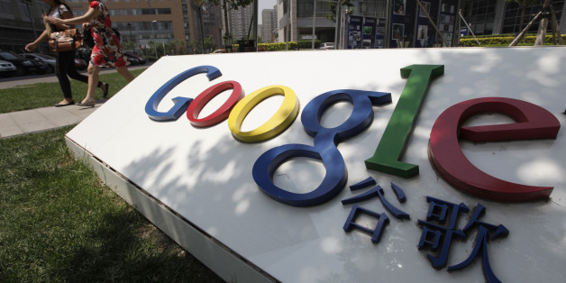 Women walk past the logo of Google in front of its former headquarters, in Beijing June 2, 2011. Suspected Chinese hackers tried to steal the passwords of hundreds of Google email account holders, including those of senior U.S. government officials, Chinese activists and journalists, the Internet company said.  This logo has been updated and is no longer in use. REUTERS/Jason Lee (CHINA - Tags: SCI TECH POLITICS)