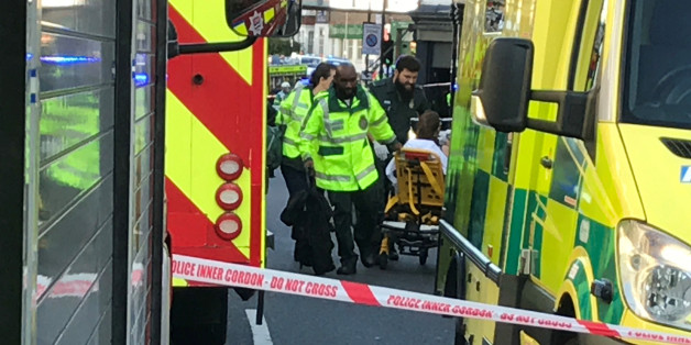 Emergency personnel attend to a person after an incident at Parsons Green underground station in London, Britain, September 15, 2017.  REUTERS/Yann Tessier