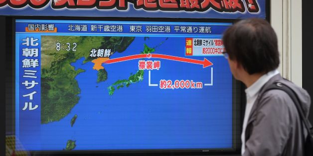 A pedestrian looks at a television screen displaying a map of Japan (R) and the Korean Peninsula in Tokyo on September 15, 2017, following a North Korean missile test that passed over Japan.North Korea fired an intermediate range ballistic missile eastwards over Japan and into the Pacific on September 15, the US said, its latest provocation amid high tensions over its banned weapons programmes.  / AFP PHOTO / Kazuhiro NOGI        (Photo credit should read KAZUHIRO NOGI/AFP/Getty Images)