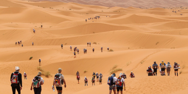 Competitors cross the dunes of Merzouga, the hightest of Morocco , some 300 kms south of Ouarzazate, during the 26th edition of the 'Marathon des Sables' (The Desert Marathon), on April 3, 2011. The 844 self-food sufficient participants walk 250 kms during seven days in the Moroccan Sahara.  AFP PHOTO PIERRE VERDY (Photo credit should read PIERRE VERDY/AFP/Getty Images)